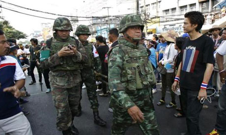 Thai military medics walk near the scene following an explosion at an anti-government protest camp at the Victory monument in central Bangkok 19 January, 2014