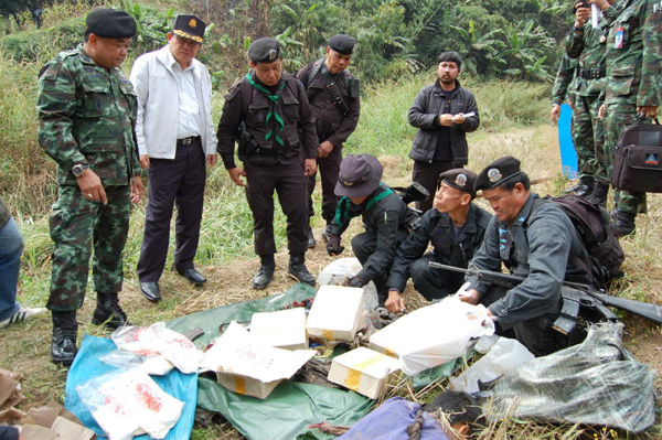 soldiers inspect drugs seized from the traffickers