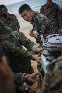 A Republic of Korea Marine pulls the chord starting a boat engine during an amphibious operations familiarization drill as part of Exercise Cobra Gold 2014 Read more: http://www.dvidshub.net/image/1166882/exercise-cobra-gold-2014#.Uv4qQ4Wz52w#ixzz2tJ7OuFOp