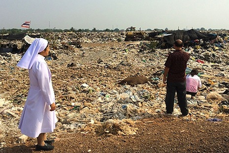 Sister Mary Clare with volunteers at the landfill outside Lopburi, Thailand Read more: http://www.ncregister.com/daily-news/thai-nuns-share-ray-of-hope-among-landfill-scavengers/#ixzz2wPVtCZif