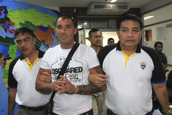 Immigration police chief Pol Lt Gen Pharnu Kherdlarpphon, second left, speaks during a press conference in Bangkok after Avelino De Jesus, bottom right, was arrested by in Nong Khai on Sunday