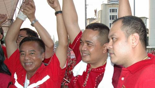 A firebrand hardliner, Mr Jatuporn Prompan (centre, seen in a file picture from 2010) who was a core leader of Thailand's Red Shirts in the country's massive 2010 protests has been chosen to head the pro-government movement