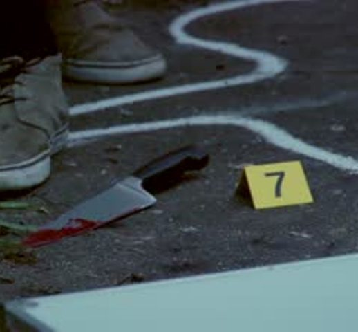 stock-footage-forensic-scientist-taking-a-blood-sample-from-a-kinfe-the-murder-weapon-at-a-crime-scene