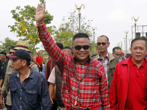 Red Shirt leader Jatuporn Prompan waves to his supporters