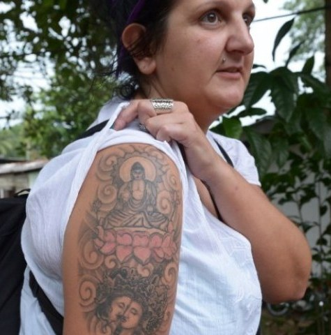 """A police spokesman said she was arrested for """"hurting others' religious feelings"""" after the tattoo of a Buddha seated on a lotus flower was spotted on her right arm"""