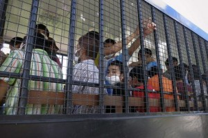 Suspected Uighurs are transported back to a detention facility in the town of Songkhla in southern Thailand after visiting women and children at a separate shelter