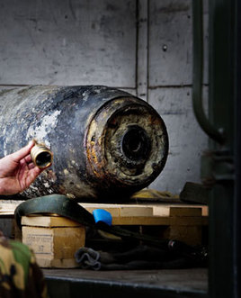 The 225-kilogram (500-pound) shell was found at a construction site by builders who then sold it to a suburban scrap metal merchant believing the bomb had been defused.