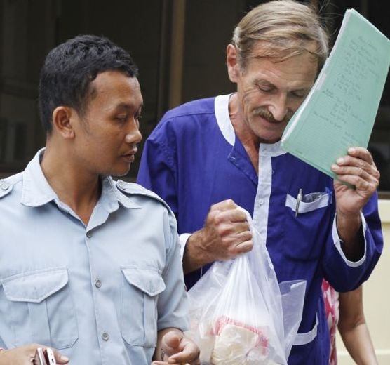 Karl Heinz Henning, 67, was convicted after police raided his flat and found four Vietnamese girls aged 10 to 14, as well as the largest pornography collection ever found in Cambodia.