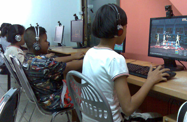 Children play online games at an outlet in Chon Buri province