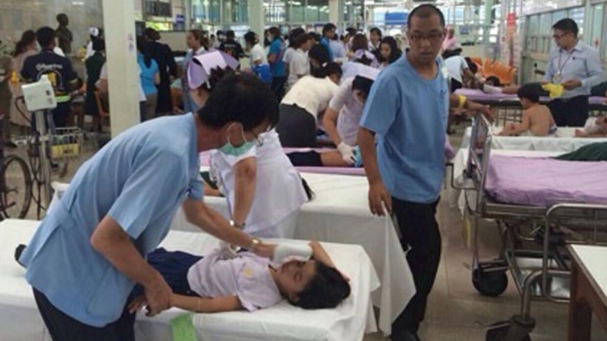 Thai doctors and nurses treat school children at a hospital after they were sickened by a chemical leak from a Hong Kong ship near their school in Laem Chabang industrial seaport in Chonburi province