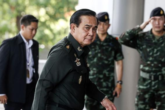 Thai Army chief General Prayuth Chan-ocha arrives before a meeting to discuss the 2015 national budget at the Army Club in Bangkok
