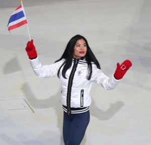 Skier Vanessa-Mae of Thailand (L) waves to the crowd during the Opening Ceremony of the Sochi 2014 Winter Olympics at Fisht Olympic Stadium