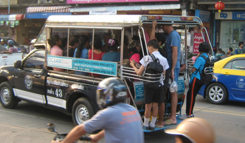 Over Loaded Baht Bus with Student hanging off Back