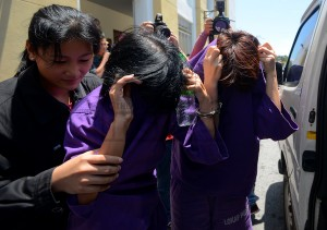 Two of the women participants at a nudist event leaving the George Town magistrate's court today - See more at: http://www.themalaysianinsider.com/malaysia/article/5-penang-beach-nudists-remanded#sthash.lTNNZzXG.dpuf