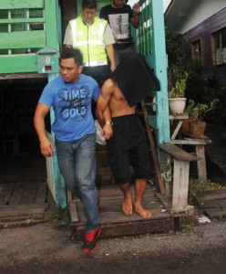 Police arresting one of the four suspects at their respective homes within the first two hours of the killing