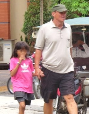 Suspected paedophile Michael Jones was arrested by Cambodian police after he was snapped strolling hand in hand with an 11-year-old girl in Phnom Pen