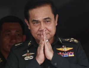 Thailand's newly appointed Prime Minister Prayuth Chan-ocha gestures in a traditional greeting during his visit to the 2nd Infantry Battalion, 21st Infantry Regiment, Queen's Guard in Chonburi