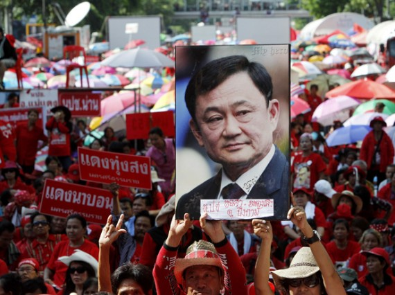 Mr. Thaksin's name was scrubbed from the book by the Ministry of Education, said the textbook's author, Thanom Anarmwat.