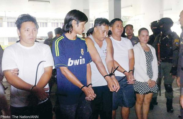 Five men suspected of being involved in the 2010 killing of then-Colonel Romklao Thuvatham appear before the press at the Royal Thai Police headquarters. - See more at: http://news.asiaone.com/news/asia/2010-thailand-political-violence-men-black-arrested#sthash.6CjFkE9j.dpuf