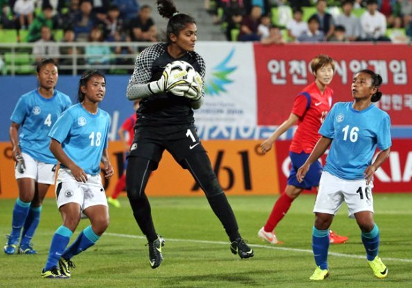 Indian goalkeeper Aditi Chauhan takes the ball during India's humiliating 10-0 defeat against Thailand.