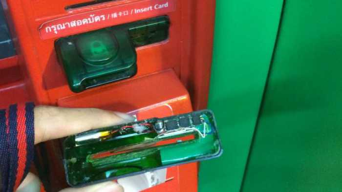 Skimming device installed on 7-11 ATM Machine