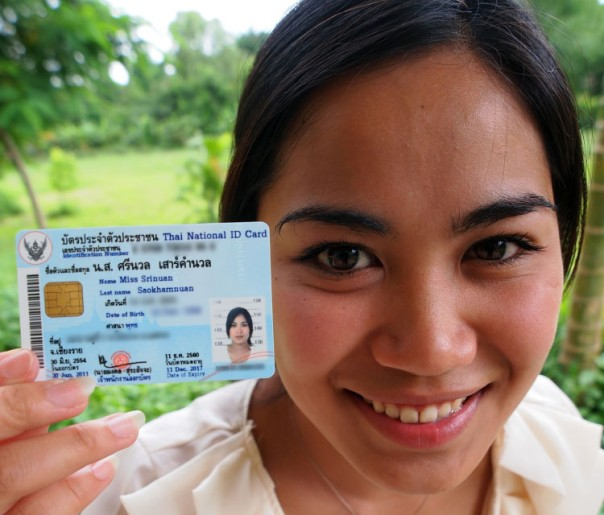 """Srinuan """"Aor"""" Saokhamnuan, who was born stateless in Thailand, holds up her new Thai identification card after authorities granted her citizenship"""