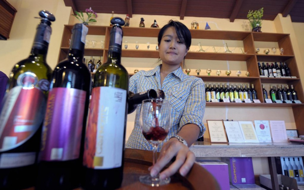 Nikki Lohitnavy, Thailand's first female winemaker tests her wine at a wineshop in Khao Yai National Park 155km (96 miles) north of Bangkok.
