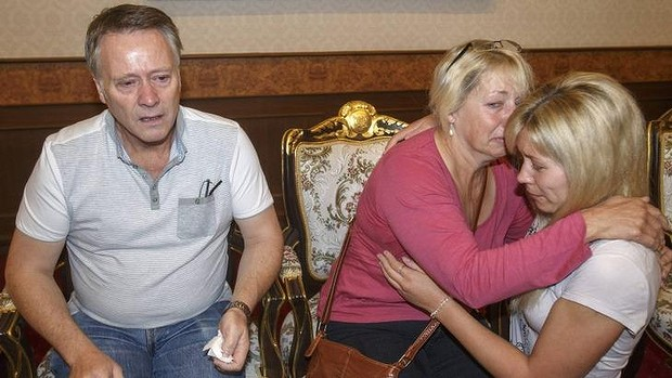 Grieving: Hannah Witheridge's family at the headquarters of the Royal Thai Police in Bangkok. Read more: http://www.smh.com.au/world/dna-tests-clear-suspects-of-murdering-british-tourists-in-koh-tao-thailand-20140918-10iw80.html#ixzz3DlmNdplo