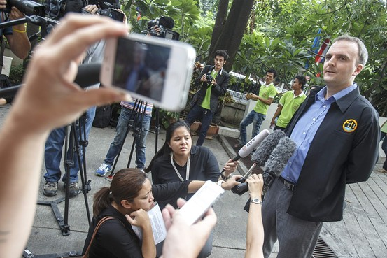 Andy Hall speaks to the media as he arrives for his trial in Bangkok on Tuesday. Athit Perawongmeth/Reuters