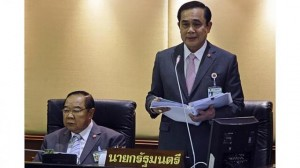 Thailand's Prime Minister Prayuth Chan-ocha (right) reads out his government's policy, as Deputy Prime Minister and Defence Minister Prawit Wongsuwan listens, at the Parliament in Bangkok - See more at: http://www.straitstimes.com/news/asia/south-east-asia/story/thailands-pm-warns-measures-protect-monarchy-against-defamation-2014#sthash.RfOSzWMV.dpuf