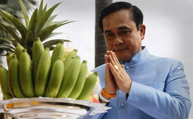 Thailand's Prime Minister Prayuth Chan-ocha prays before the first cabinet meeting.