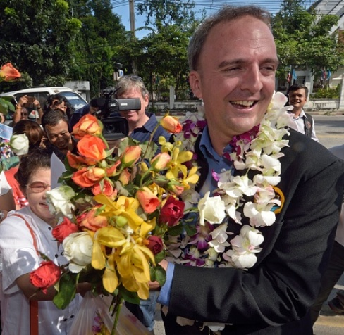 British human rights activist Andy Hall arrives at Phra Khanong provincial court for his verdict on criminal and civil defamation cases filed against him