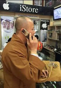 Venerable Sir Thich Thanh Cuong is pictured holding a Vertu mobile phone in Hai Duong Province, located in northern Vietnam, in this photo posted on his Facebook