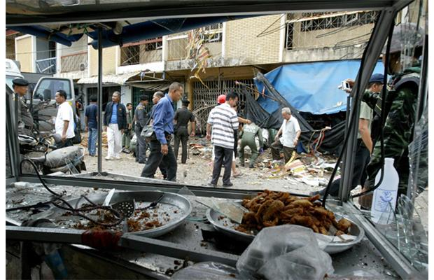 Thai bomb squad units inspect the site of an explosion at a restaurant in Pattani province