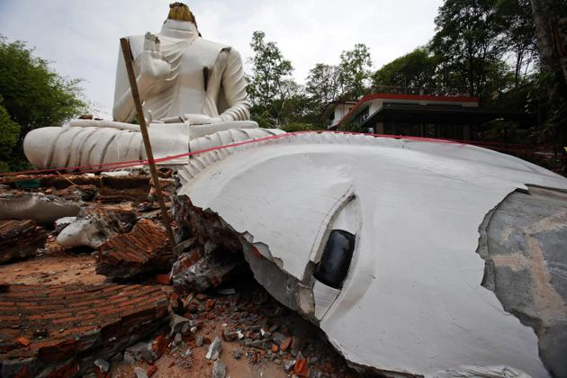 A Buddha statue, damaged by an earthquake, is seen at the Udomwaree temple