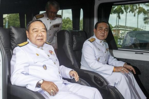 Thailand's Prime Minister Prayuth Chan-ocha (R) and Deputy Prime Minister and Defence Minister Prawit Wongsuwan (L) leave Government House as they lead a new cabinet to an audience with King Bhumibol Adulyadej at Siriraj Hospital in Bangkok