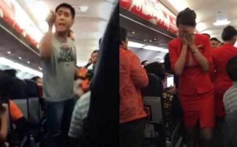 Trouble in the air: a passenger yells at staff, while a stewardess is reduced to tears