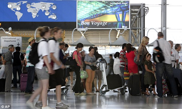 Tourists wait for their departure at the Suvarnabhumi Airport