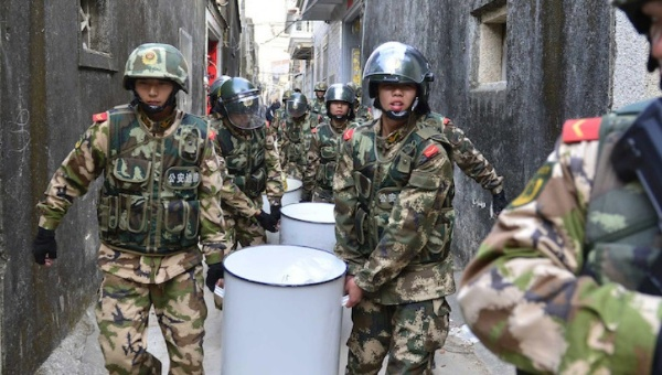 Chinese authorities carrying out drug from a raid.