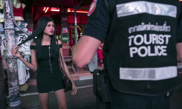 A Thai ladyboy is round up by the tourist police