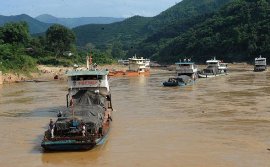More than 20 large cargo ships have been stranded in the river for nearly a week, roughly 120 kilometers north of Chiang Rai province.