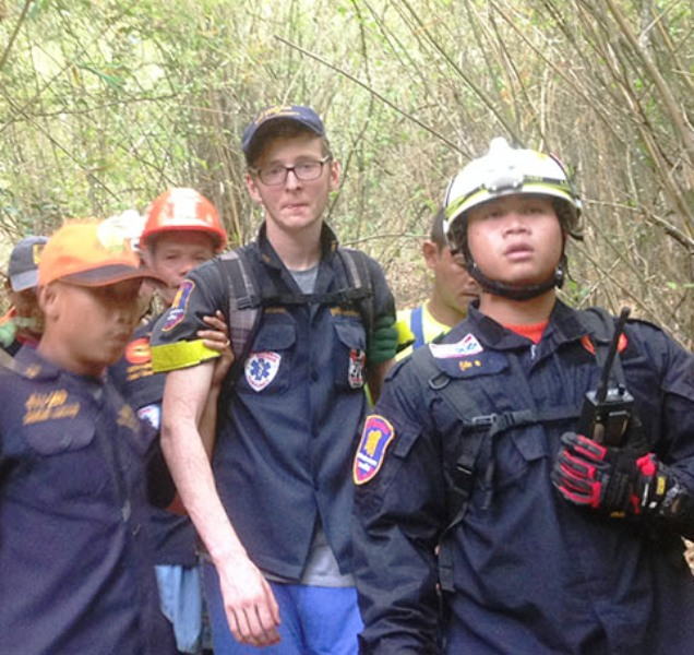 German tourist Michael Heck-Roth is rescued after getting lost and being stranded overnight on a mountain cliff in Khao Ta Mong Lai Forest Park for almost a day. (Photo by Chaiwat Satyaem)