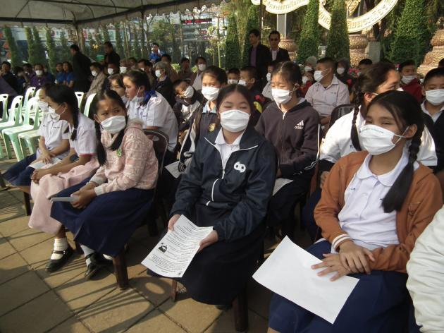 Students wear face masks to prevent breathing smoke and ash