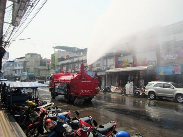 Fire Truck Sprays water to try and reduce ash in air