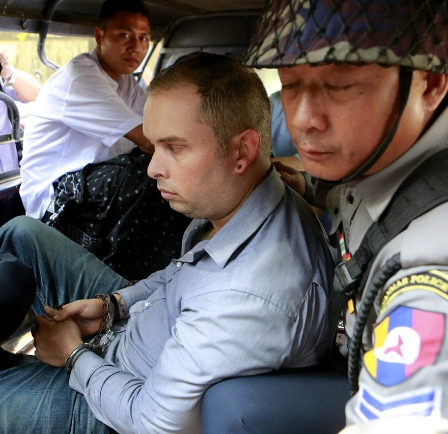 New Zealand citizen Philip Blackwood, 32, is escorted by Myanmar policemen after being sentenced two and a half years in prison in Yangon, Myanmar,