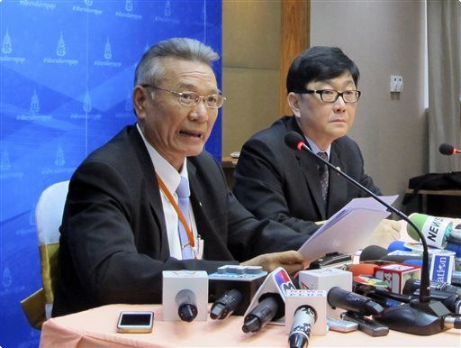Attorney General Office's prosecutor Surasak Threerattrakul, left, speaks next to Deputy Spokesman, Office of the Attorney General, Kosonlavat Intujunyong at a press conference in Bangkok - See more at: http://readingeagle.com/ap/article/thai-ex-premier-says-democracy-is-dead-after-impeachment#sthash.2EIYpCZm.dpuf