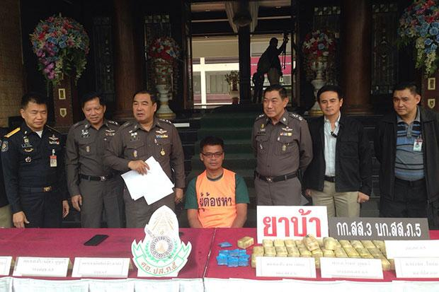 Chawig Malai (middle) is presented at a press conference announcing his arrest on drug charges in Chiang Mai. (Photo by Cheewin Sattha)
