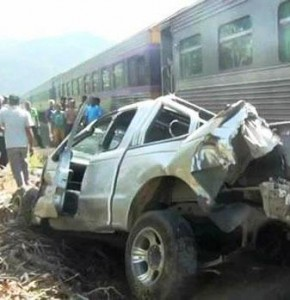 A man was badly injured after his pickup truck was smashed by a moving train in Trang province on Wednesday. (Photo by Methee Muangkaew)