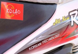 """Kolao Group boasts """"Korean Technology"""" on its motorcycles, like the one pictured here in Savannakhet, Laos."""