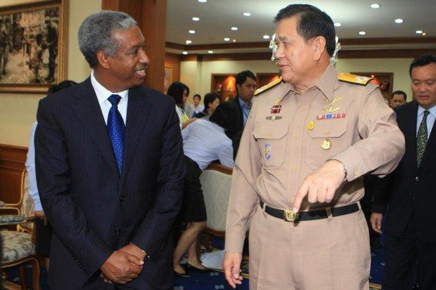 Ethiopian Yonas Tegegn of the World Health Organisation, seen here while receiving a five-million baht donation to WHO from Foreign Minister Tanasak Patimapragorn last September, has been accused of keeping...  Please credit and share this article with others using this link:http://www.bangkokpost.com/news/general/515351/police-call-in-who-official-over-maid-abuse. View our policies at http://goo.gl/9HgTd and http://goo.gl/ou6Ip. © Post Publishing PCL. All rights reserved.